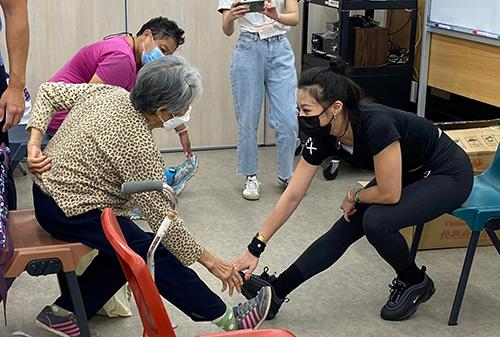 Stretching workshops encourage elders to exercise at home du…